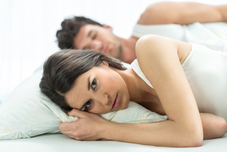 man-and-woman-annoyed-bed-horiz