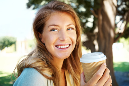 Happy Woman Drinking Coffee Outdoors Horiz