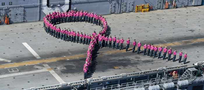 sailors_stand_in_a_pink_ribbon_formation_at_sea700.